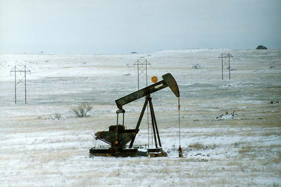Oil pump in snowy field at McKnight Ranch